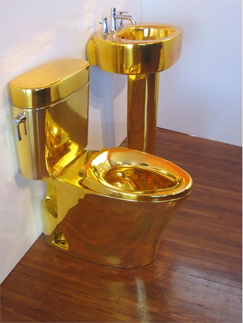 Gold plated toilet with gold plated basin/sink