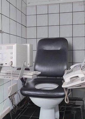Funny toilet with computer and telephone